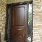 Wood door with vinyl frame