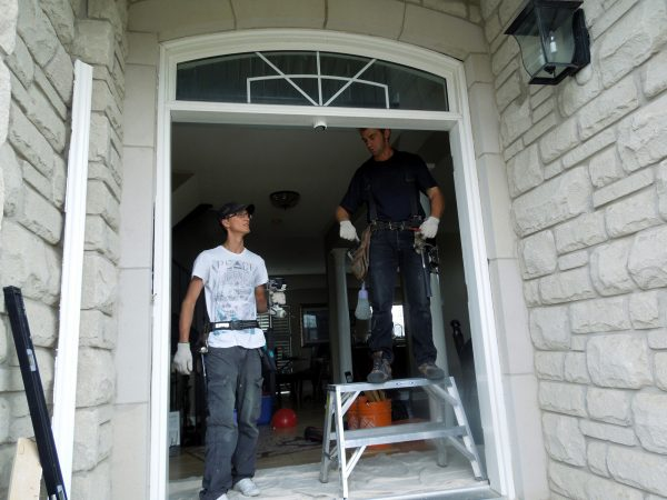 Heritage Home Design staff replacing a front door