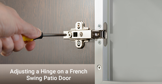 A man adjusting hinge on a french swing patio door.